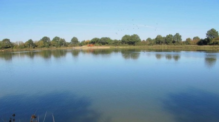 view-from-south-bank-towards-entrance-facilities-at-anjou-lake